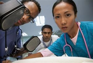 Medical team treats a patient. (Image credit to Jupiter Images).